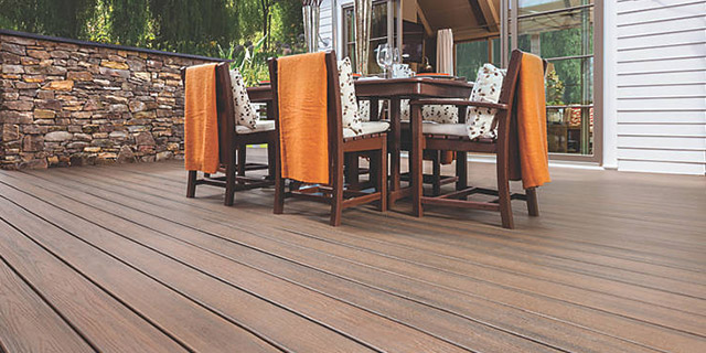 Outdoor patio area featuring Trex Transcend Tropical deck boards in Spiced Rum